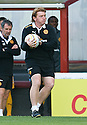 MOTHERWELL MANAGER STUART MCCALL GETS THE BALL QUICKLY BACK INTO PLAY