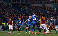 Calcio, Serie A: Roma vs Inter. Roma, stadio Olimpico, 19 marzo 2016.<br /> Roma's Radja Nainggolan, bottom right, kicks to score the equalizer goal during the Italian Serie A football match between Roma and FC Inter at Rome's Olympic stadium, 19 March 2016. The game ended 1-1.<br /> UPDATE IMAGES PRESS/Riccardo De Luca