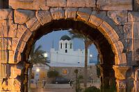 Tripoli, Libya - Marcus Aurelius Roman Arch, 163-64 A.D., Tripoli Medina (Old City), at dusk.  Mosque of Sidi Abdul Wahab behind.