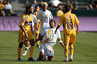 Los Angeles Galaxy's Carlos Pavon looks up at Tigres UNAL Fabian Cubero after being fouled in the first half during the World Series of Football at the Home Depot Center in Carson, CA on Tuesday, July 17, 2007..(Matt A. Brown)