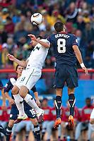 Clint Dempsey (R) of USA and Zlatan Ljubijanki (L) od Slovenia