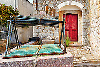 Abandoned traditional well in the medieval mastic village of Vessa on the island of Chios, Greece