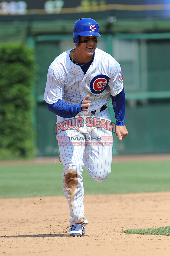 Chicago Cubs first baseman Anthony Rizzo #44 runs to third during a game against the Arizona Diamondbacks at Wrigley Field on July 15, 2012 in Chicago, Illinois. The Cubs defeated the Diamondbacks 3-1. (Tony Farlow/Four Seam Images).