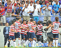 Clarence Goodson (21) of the USMNT celebrates with teammate his score.  The USMNT defeated El Salvador 5-1 at the quaterfinal game of the Concacaf Gold Cup, M&T Stadium, Sunday July 21 , 2013.