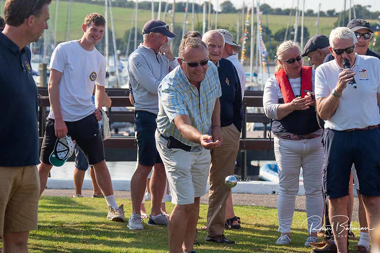Former Admiral Hugh Mockler tries his hands at boules on the club lawn