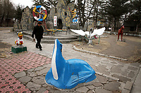 China. Jilin Province. A man walks through a park filled with animal statues in the town of Yanji, close to the border with North Korea. The town is part of the Korean Autonomous Prefecture in the north-east of the country. 2011
