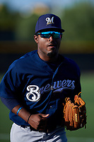 AZL Brewers Blue left fielder Jackie Urbaez (8) jogs off the field between innings of an Arizona League game against the AZL Royals at Surprise Stadium on June 18, 2019 in Surprise, Arizona. AZL Royals defeated AZL Brewers Blue 12-7. (Zachary Lucy/Four Seam Images)
