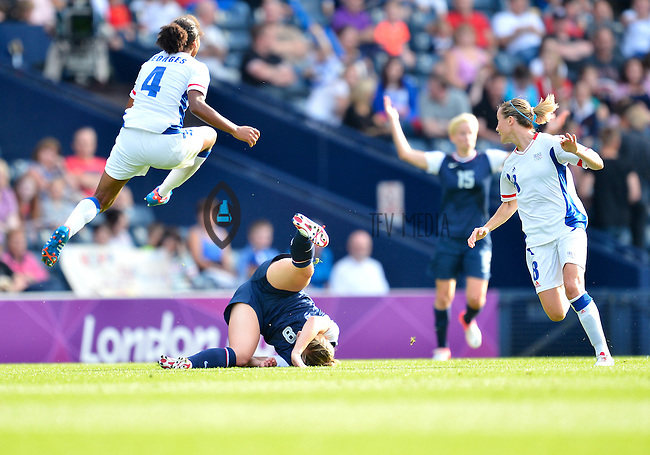 July 25, 2012..Amy Rodriguez (8), Laura Georges (4), France's Sonia Bompastor (8). USA vs France Football match during 2012 Olympic Games at Hampden Park in Glasgow, England. USA defeat France 4-2 after conceding two goals in the first half of the match...(Credit Image: © Mo Khursheed/TFV Media)