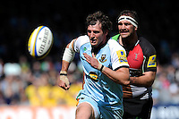 Tom Wood of Northampton Saints (left) and Olly Kohn of Harlequins chase down a loose ball during the Aviva Premiership match between Harlequins and Northampton Saints at the Twickenham Stoop on Saturday 4th May 2013 (Photo by Rob Munro)