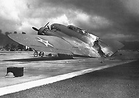 A burned B-17C aircraft rests near Hangar Number Five, Hickam Field, following the attack by Japanese aircraft.  Pearl Harbor, Hawaii.  December 7, 1941.   (Navy)<br /> NARA FILE #:  080-G-32915<br /> WAR & CONFLICT BOOK #:  1139