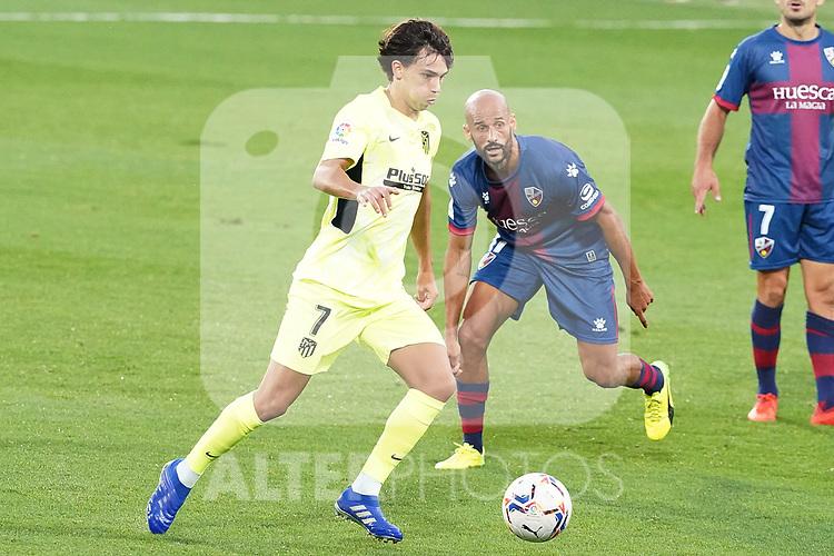 SD Huesca's Mikel Rico (r) and Atletico de Madrid's Joao Felix during La Liga match. September 30,2020. (ALTERPHOTOS/Acero)