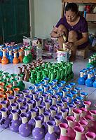 Yogyakarta, Java, Indonesia.  Woman Painting Vases.
