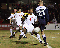 Ethan White #4 of the University of Maryland stops a blast from Mackenzie Arment #21 of Penn State during an NCAA 3rd. round match at Ludwig Field, University of Maryland, College Park, Maryland on November 28 2010.Maryland won 1-0.