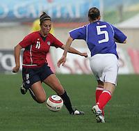 MAR 13, 2006: Faro, Portugal:  USWNT midfielder (11) Carli Lloyd jukes around  France defender (5) Sabrina Viguier in the Algarve Cup in Faro Portugal.