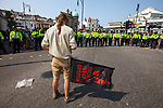 © Joel Goodman - 07973 332324 . 24/04/2011 . Brighton , UK . A large line of police separate antifascist demonstrators from MFE marchers outside Brighton railway station . Nationalist street movement March for England holds a march and rally in Brighton , opposed by antifascists . Photo credit : Joel Goodman