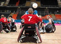 18 APR 2012 - LONDON, GBR - Great Britain's Mike Kerr (GBR) (Class 1.5) (#7) puts the ball back into play during the London International Invitational Wheelchair Rugby Tournament match against Canada at the Olympic Park Basketball Arena in Stratford, London, Great Britain (PHOTO (C) 2012 NIGEL FARROW)