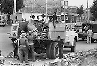 Street urchins collecting sorting through garbage in Bogota, Colombia  - Child labor as seen around the world between 1979 and 1980 – Photographer Jean Pierre Laffont, touched by the suffering of child workers, chronicled their plight in 12 countries over the course of one year.  Laffont was awarded The World Press Award and Madeline Ross Award among many others for his work.