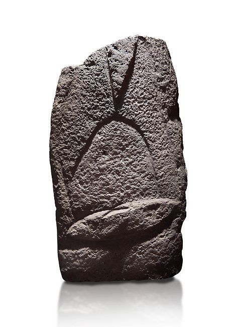 Late European Neolithic prehistoric Menhir standing stone with carvings on its face side. The representation of a stylalised male figure starts at the top with a long nose from which 2 eyebrows arch around the top of the stone. below this is a carving of a falling figure with head at the bottom and 2 curved arms encircling a body above. at the bottom is a carving of a dagger running horizontally across the menhir. Excavated from Cabamadau, Villa Sant' Antonia. Menhir Museum, Museo della Statuaria Prehistorica in Sardegna, Museum of Prehoistoric Sardinian Statues, Palazzo Aymerich, Laconi, Sardinia, Italy. White background.