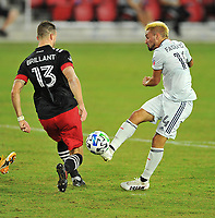 WASHINGTON, DC - SEPTEMBER 27: Diego Fagundez #14 of New England Revolution battles for the ball with Frederic Brilliant #13 of D.C. United during a game between New England Revolution and D.C. United at Audi Field on September 27, 2020 in Washington, DC.