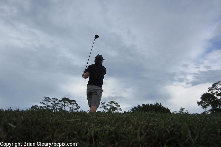 A golfer hits a drive on the 17th holes, Daytona Beach Golf Course, Daytona Beach, Florida, July 2014.  (Photo by Brian Cleary/www.bcpix.com)