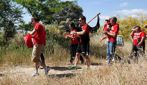 04 JUN 2011 - MADRID, ESP - The Ivan Rana Fan Club make their way back down the hill to watch him on the run during the Madrid round of triathlon's ITU World Championship Series .(PHOTO (C) NIGEL FARROW)