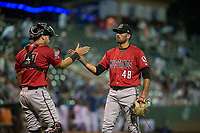 Billings Mustangs relief pitcher Andrew McDonald (48) is congratulated by Pabel Manzanero (47) after a Pioneer League game against the Ogden Raptors at Lindquist Field on August 17, 2018 in Ogden, Utah. The Billings Mustangs defeated the Ogden Raptors by a score of 6-3. (Zachary Lucy/Four Seam Images)