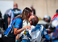 Sep 15, 2019; Mohnton, PA, USA; NHRA pro stock motorcycle rider Scotty Pollacheck kisses wife Susan during the Reading Nationals at Maple Grove Raceway. Mandatory Credit: Mark J. Rebilas-USA TODAY Sports