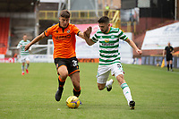 22nd August 2020; Tannadice Park, Dundee, Scotland; Scottish Premiership Football, Dundee United versus Celtic; Lewis Neilson of Dundee United challenges for the ball with Greg Taylor of Celtic