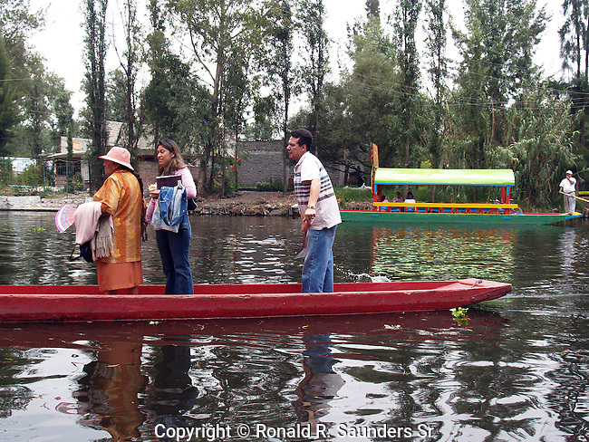 """[UNESCO WORLD HERITAGE SITE]<br /> <br />  Xochimilco is one of the sixteen boroughs within Mexican Federal District. Today, the borough consists of eighteen neighborhoods along with fourteen villages that surround it. While the neighbhoods are somewhat in the geographic center of the Federal District, it is considered to be """"south"""" and has an identity separate from the historic center of Mexico City. Xochimilco is best known for its canals, which are left from what was an extensive lake and canal system that connected most of the settlements of the Valley of Mexico. These canals, along with artificial islands called chinampas, attract tourists and other city residents to ride on colorful gondolas called<br /> """"trajineras"""" Its Hispanic past, has made Xochimilco a World Heritage Site."""