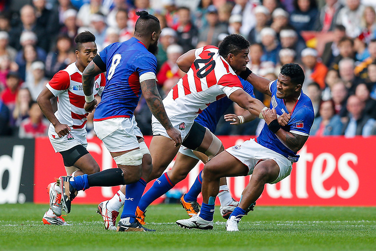 Japan replacement Amanaki Lelei Mafi is tackled by Samoa Outside Centre Paul Perez - Mandatory byline: Rogan Thomson - 03/10/2015 - RUGBY UNION - Stadium:mk - Milton Keynes, England - Samoa v Japan - Rugby World Cup 2015 Pool B.