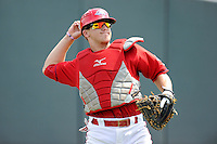 Catcher Jake Romanski (12) of the Greenville Drive warms up before a game against the Augusta GreenJackets on Sunday, July 13, 2014, at Fluor Field at the West End in Greenville, South Carolina. Greenville won, 8-5. (Tom Priddy/Four Seam Images)