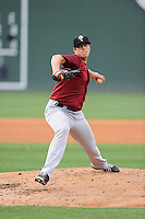 Pitcher Brad Wieck (14) of the Savannah Sand Gnats, bats delivers a pitch in a game against the Greenville drive on May 7, 2015, at Fluor Field at the West End in Greenville, South Carolina. Savannah won, 7-5. (Tom Priddy/Four Seam Images)