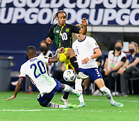 DALLAS, TX - JULY 25: Shaq Moore #20 of the United States strips the ball from Bobby Reid #10 of Jamaica during a game between Jamaica and USMNT at AT&T Stadium on July 25, 2021 in Dallas, Texas.