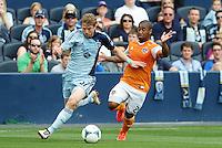 Jacob Peterson (37) Sporting KC holds off Corey Ashe (26) defender Houston Dynamo ..Sporting Kansas City and Houston Dynamo played to a 1-1 tie at Sporting Park, Kansas City, Kansas.