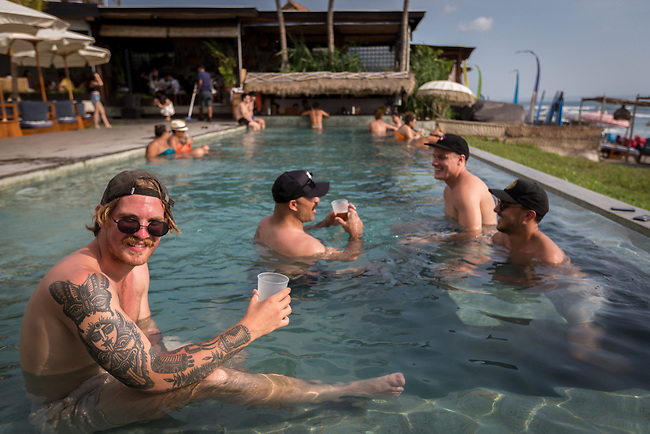 6 DECEMBER, 2019 BALI, INDONESIA: Ben Strickland (left, 21)and his mates Toby McGrath (39) Mitch Browne (23) and Brendan Erceg (23) from Perth relax in the pool at The Lawn beach club in Canggu, Bali. There has been a levelling out of Australian tourist numbers to Bali in recent times and tastes are changing regarding what people want from their holiday. Millennials are being targeted by tourism authorities and they want to give them more boutique experiences than just beach and beer. Picture by Graham Crouch/The Australian