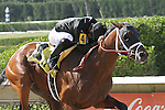 April 5, 2014:  #4 Our Caravan with jockey Manoel Cruz on board upsets 1/5 favorite #2 Ring Weekend with jockey Alan Garcia  by 9 3/4 lengths to win the Calder Derby Stakes at Calder Race Course in Miami Gardens, FL. Liz Lamont/ESW/CSM