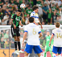 AUSTIN, TX - JUNE 19: Julio Cascante #18 of Austin FC heads the ball away from his goal during a game between San Jose Earthquakes and Austin FC at Q2 Stadium on June 19, 2021 in Austin, Texas.