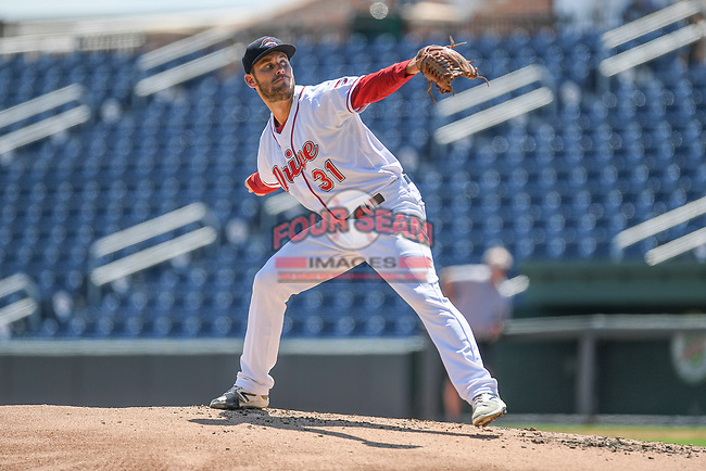 """Former Greenville Drive pitcher Madison Younginer pitches in a """"Sandlot""""-style game to other pro and amateur players from the region on Thursday, June 25, 2020, at Fluor Field at the West End in Greenville, South Carolina, as team workouts remain shut down. (Tom Priddy/Four Seam Images)"""