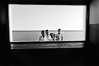 Mozambique. Province of Maputo. Manhiça is a small town (80 km north of the capital Maputo).The non governmental organisation (ngo) Médecins Sans Frontières (MSF) of Switzerland has rehabilitated the local hospital. Children play games in the fresh painted corridors. © 1992 Didier Ruef