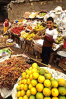 Vendor men selling fruits and vegetables in market in Cairo Egypt
