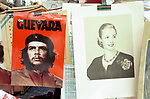 Two Argentinean heroes Eva Peron and Che Guevara. These posters are for sale in the Sunday weekly flea market in Plaza Dorregoin the SanTelmo area of Buenos Aires.