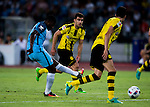 Manchester City striker Kelechi Iheanacho (l) plays against Borussia Dortmund defender Sokratis Papastathopoulos (c) during the match between Manchester City FC during their 2016 International Champions Cup China match at the Shenzhen Stadium on 28 July 2016 in Shenzhen, China. Photo by Marcio Machado / Power Sport Images
