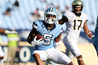 CHAPEL HILL, NC - NOVEMBER 14: Dazz Newsome #5 of North Carolina carries the ball during a game between Wake Forest and North Carolina at Kenan Memorial Stadium on November 14, 2020 in Chapel Hill, North Carolina.