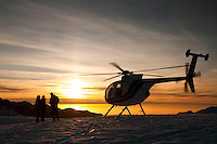 Tourists enjoying spectacular sunset on the Chancellor Shelf in the upper parts of the Fox Glacier and looking toward the Tasman Sea on the horizon - Westland National Park, West Coast, New Zealand