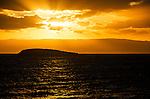 Sun setting over Picnic Island, located off the seaside town of Coles Bat=y, gateway to Freycinet National Park, Tasmania, Australia