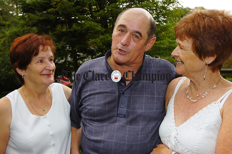 Benny Stanley,Offaly, works up a sweat dancing with two ladies Marie Mennis (left) and Chris Sheridan at the Spa Wells Lisdoonvarna during the matchmaking festival.Pic Arthur Ellis.