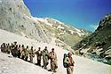 Iraq 1989.Nawshirwan Mustafa  with peshmergas in the mountains near the Iranian border on their way to meet the Kurdish front  Irak 1989 Nawshirwan Mustafa avec des peshmergas dans les montagnes pres de la frontiere iranienne en route pour renconter le front du Kurdistan