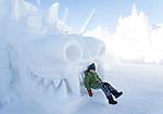 child in snow castle