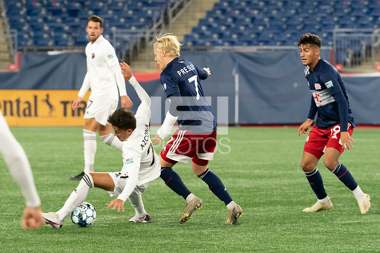 FOXBOROUGH, MA - OCTOBER 09: Edison Azcona #21 of Fort Lauderdale CF and Connor Presley #7 of New England Revolution II collide in the midfield during a game between Fort Lauderdale CF and New England Revolution II at Gillette Stadium on October 09, 2020 in Foxborough, Massachusetts.