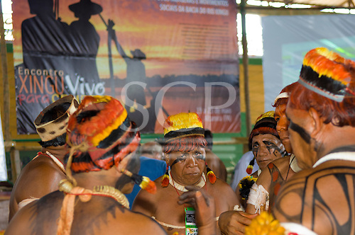 """Altamira, Brazil. """"Xingu Vivo Para Sempre"""" protest meeting about the proposed Belo Monte hydroeletric dam and other dams on the Xingu river and its tributaries. Chiefs from the Xingu Indigenous Park dicuss their concerns. Poster """"Xingu alive for ever""""."""
